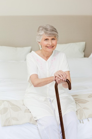 Retired woman with her walking stick  photo