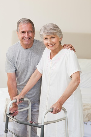 bed frame: Man helping his wife to walk