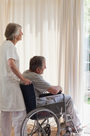 Retired couple looking out the window  photo