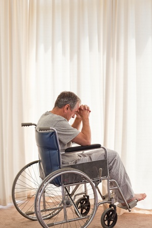 amputation: Thoughtful man in his wheelchair Stock Photo