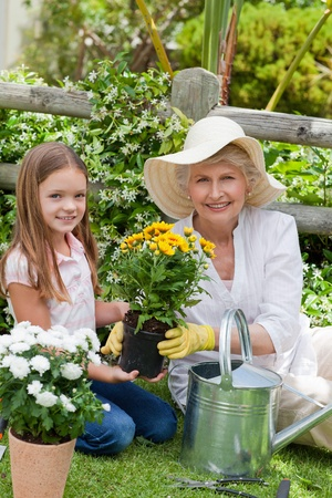 Grandmother with her granddaughter working in the garden Stock Photo - 10206315