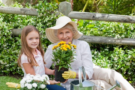Grandmother with her granddaughter working in the garden Stock Photo - 10206422