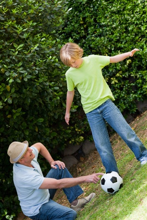 Grandfather and his grandson playing football Stock Photo - 10206441