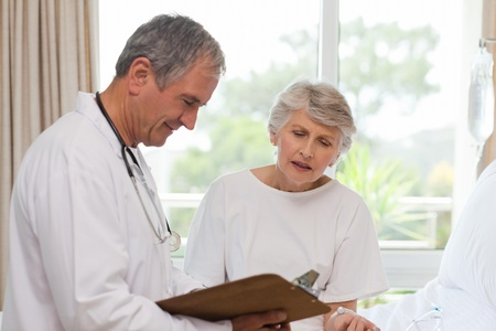 Mature doctor with his patient Stock Photo - 10193174