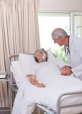Senior doctor with his sick patient photo