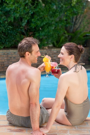 Happy couple drinking cocktails and toasting each other Stock Photo - 10198625