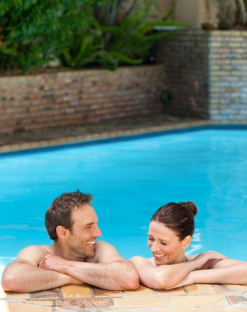 Lovely couple  in the swimming pool photo
