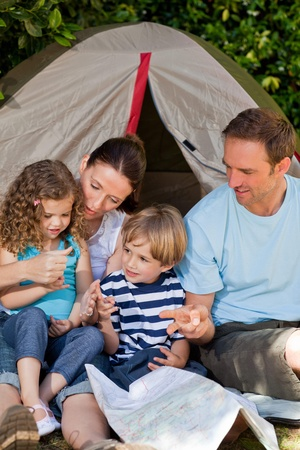 Adorable family camping in the garden photo