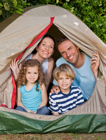 Joyful family camping in the garden photo