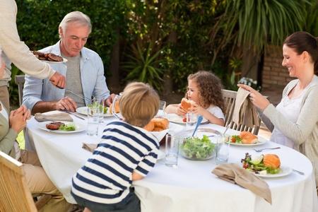 Family eating in the garden Stock Photo - 10197984