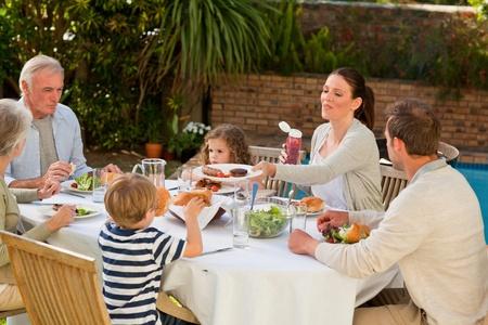 Adorable family eating in the garden Stock Photo - 10197979