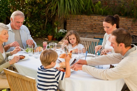 Adorable family eating in the garden Stock Photo - 10197943