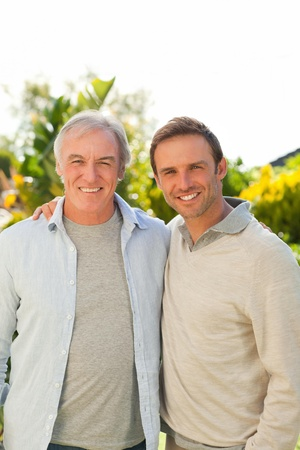 Father and his son looking at the camera in the garden Stock Photo - 10191751