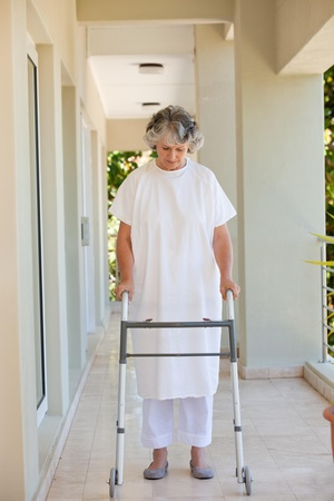 Senior woman with her zimmer frame  photo