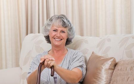 one senior adult woman: Mujer con su bast�n