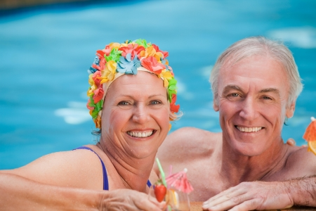 Happy mature couple in the swimming pool  photo