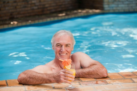 Senior man in his swimming pool photo