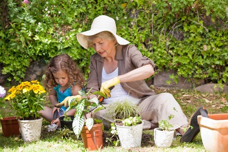Happy Grandmother with her granddaughter working in the garden Stock Photo - 10205878