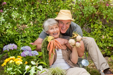Man hugging his woman in the garden photo