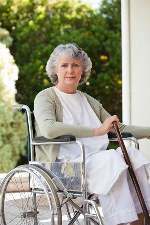 Senior woman in her wheelchair  photo
