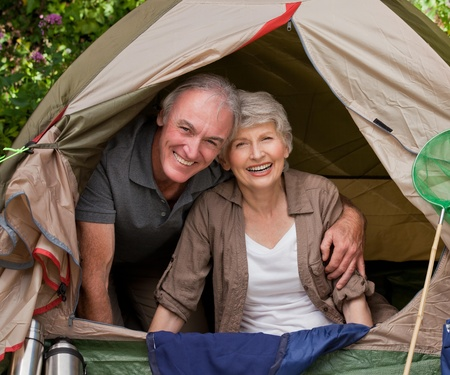 Happy couple camping in the garden photo