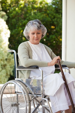 Senior woman in her wheelchair  photo