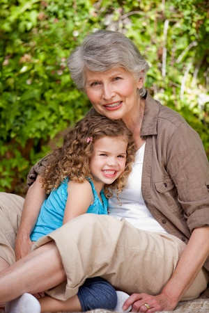Grandmother with her granddaughter in the garden photo