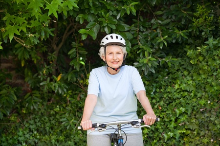 Mature woman mountain biking outside Stock Photo - 10197852