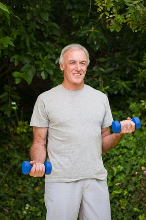 Senior man doing his exercises in the garden Stock Photo - 10197902