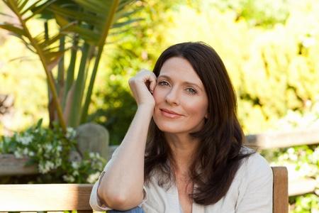 Portrait of a pretty woman in the garden photo