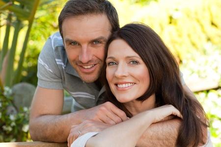 Joyful couple hugging in the garden photo