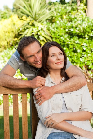 Glad couple hugging in the garden photo