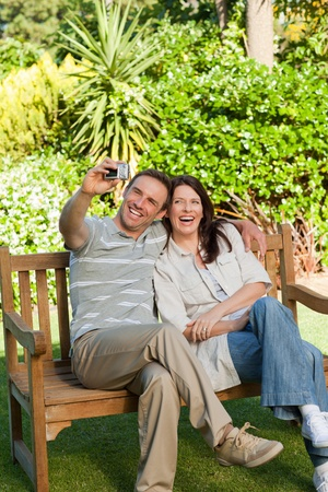 Lovers taking a photo of themselves in the garden photo