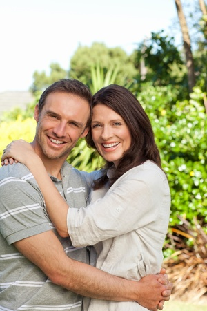 Enamored couple in the garden Stock Photo - 10198932
