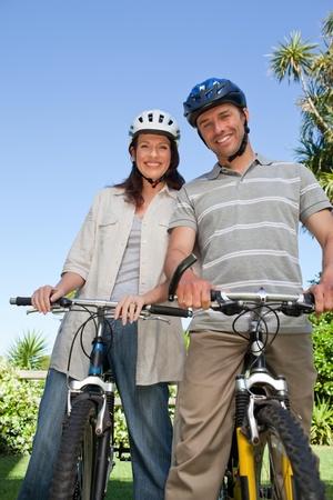Joyful couple with their bikes photo