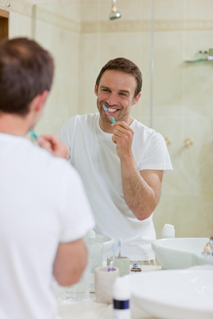 Man brushing his teeth photo