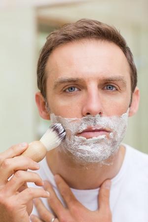 Man shaving in the bathroom photo