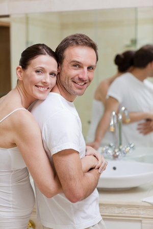 Couple hugging in the bathroom photo