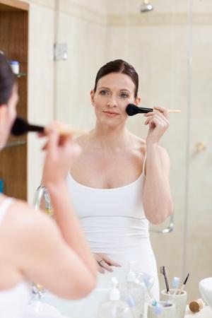 Beautiful women putting make up on  photo