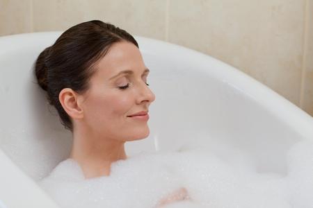 Beautiful woman taking a bath photo