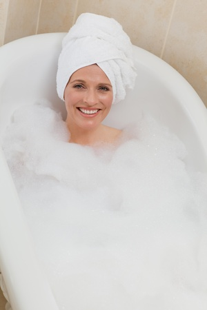 Lovely woman taking a bath with a towel on her head Stock Photo - 10192845