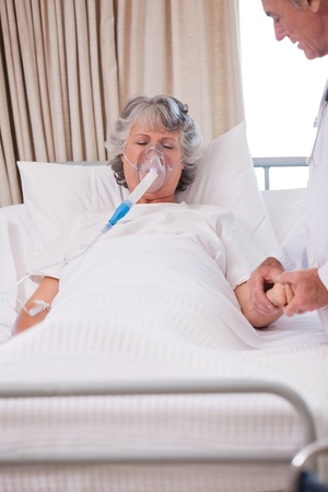 Senior doctor with his sick patient Stock Photo - 10194592