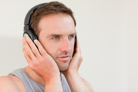 Handsome man listening to some music photo