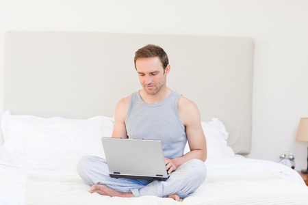 Man working on his laptop at home Stock Photo - 10192620