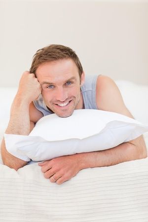Man lying down on his bed photo