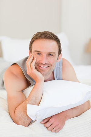 Man lying down on his bed Stock Photo - 10193164