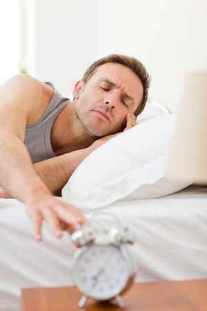 Man waking up in his bed Stock Photo - 10193112
