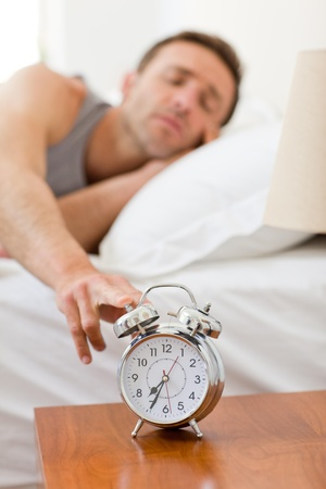 Man waking up in his bed Stock Photo - 10194662