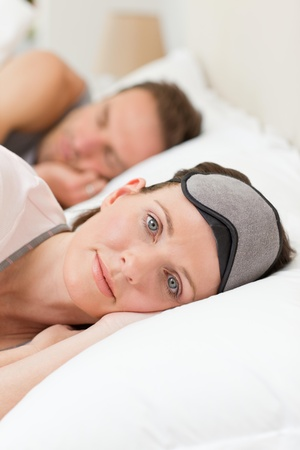 Lovely couple lying down in their bed photo