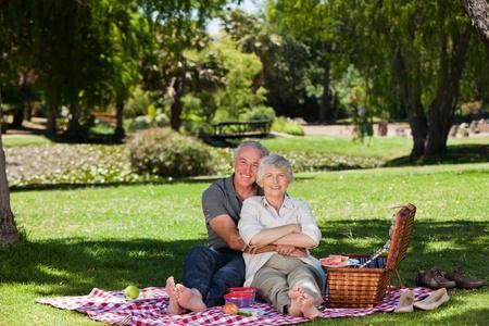 Elderly couple  picnicking in the garden  photo